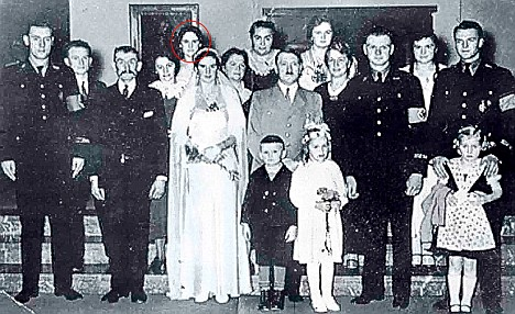 At the wedding of her sister (top row, far left)